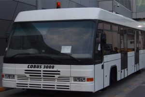 Apron Bus Cobus 3000 standing in front of a terminal